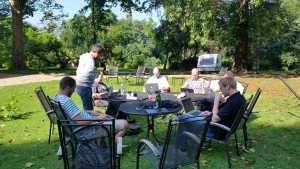 FreeBSD developers with laptops outside in the sun